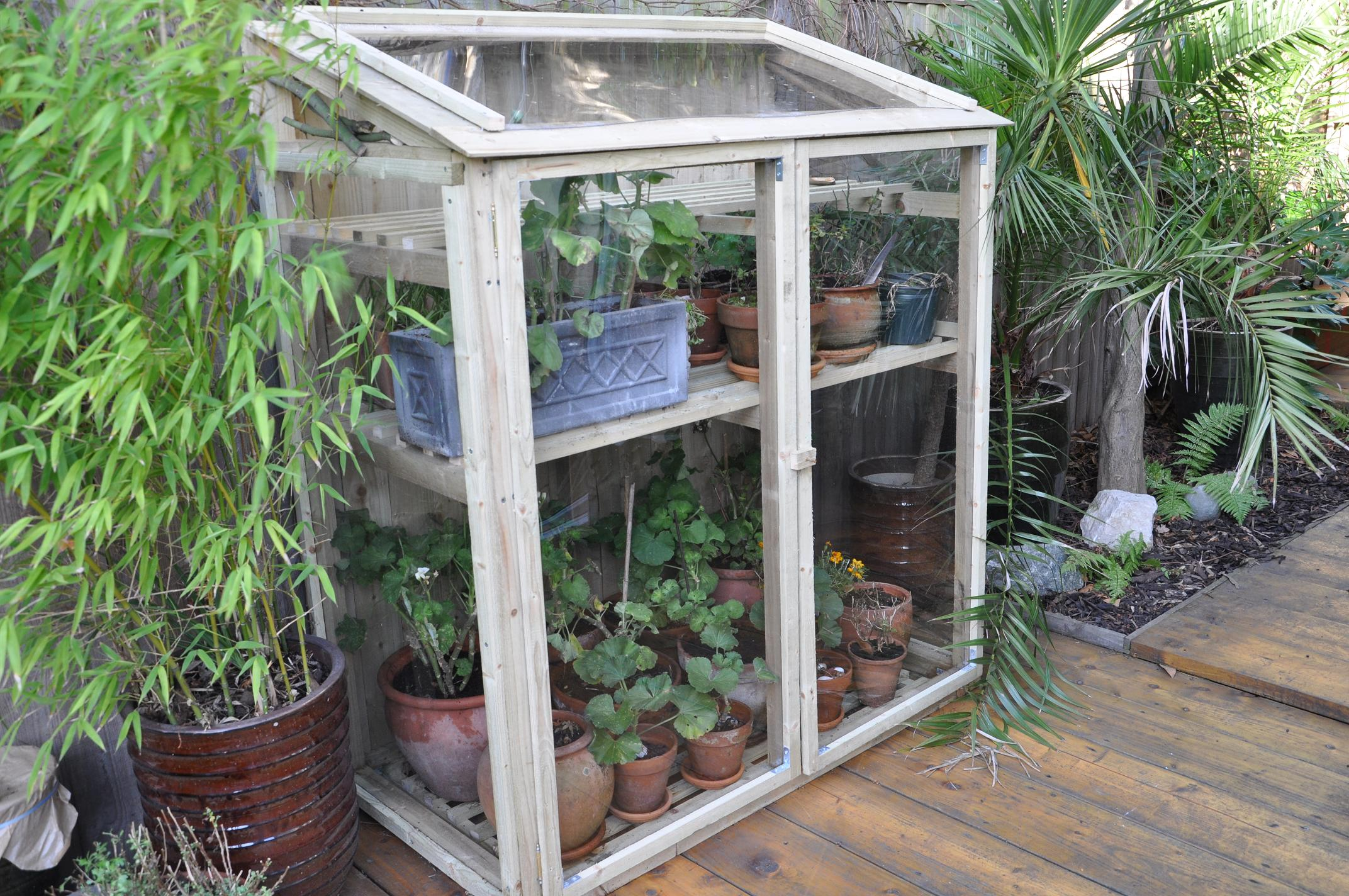 mini greenhouse tinybloomingplaces. Black Bedroom Furniture Sets. Home Design Ideas